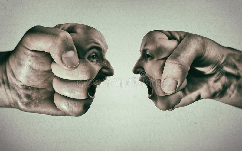 Clash of two fists on light background. Two fists with a male and female face collide with each other on light background. Concept of confrontation, competition stock image