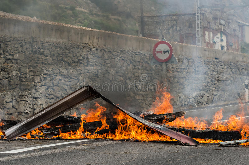 Clashes between miners and anti riot police. After striking miners of Ciñera, Léon, barricade a national street and railway, roughly 50 riot police of the stock photos