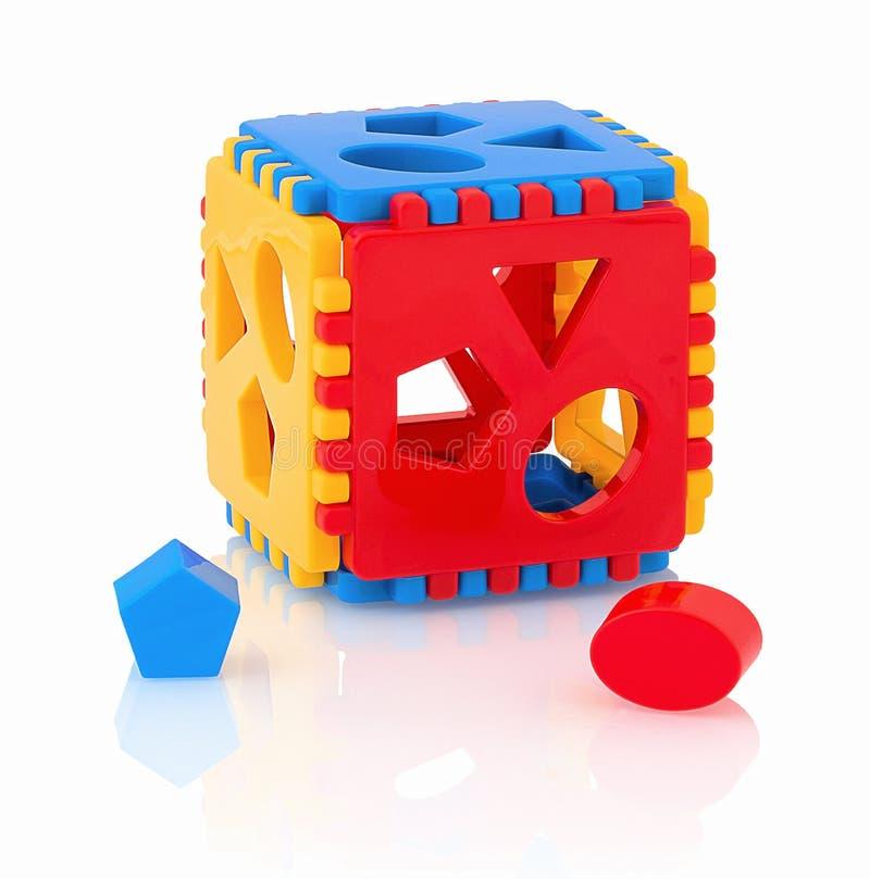 Clasificador colorido de la forma del juguete del ` s de los niños aislado en el fondo blanco con la reflexión de la sombra El cl imagen de archivo libre de regalías