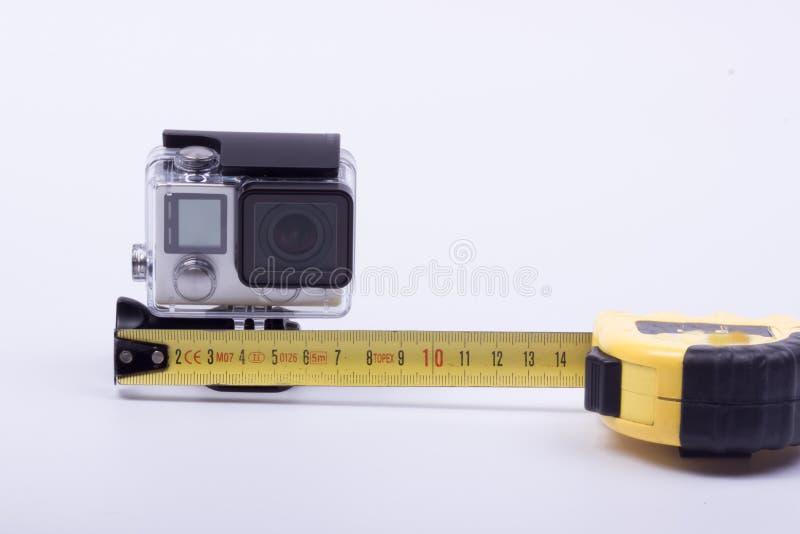 Clasifique la leva de la acción de la cámara en un fondo blanco fotografía de archivo