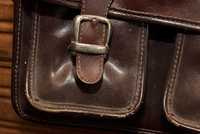 Clasp on the pocket. Of an old leather case royalty free stock images