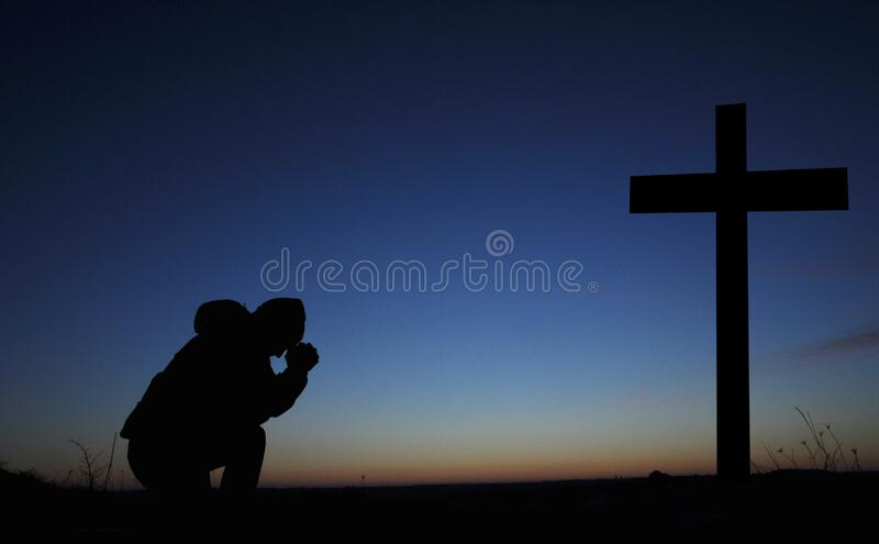 Clasped hands in prayer. Asks God. Bending his knees at the cross. A man is praying. Easter illustration. Clasped hands in prayer. Asks God. Bending his knees stock image