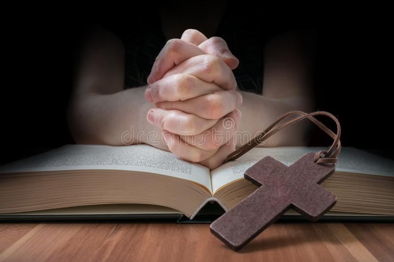 Clasped hands of prayer. Low key photo.  royalty free stock images