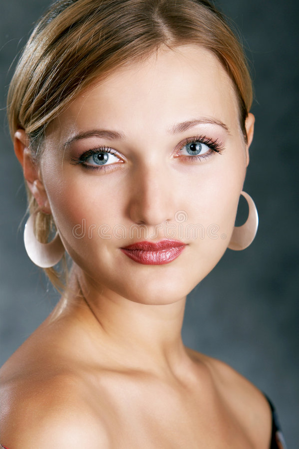 Class act high society woman. On a dark background royalty free stock photo