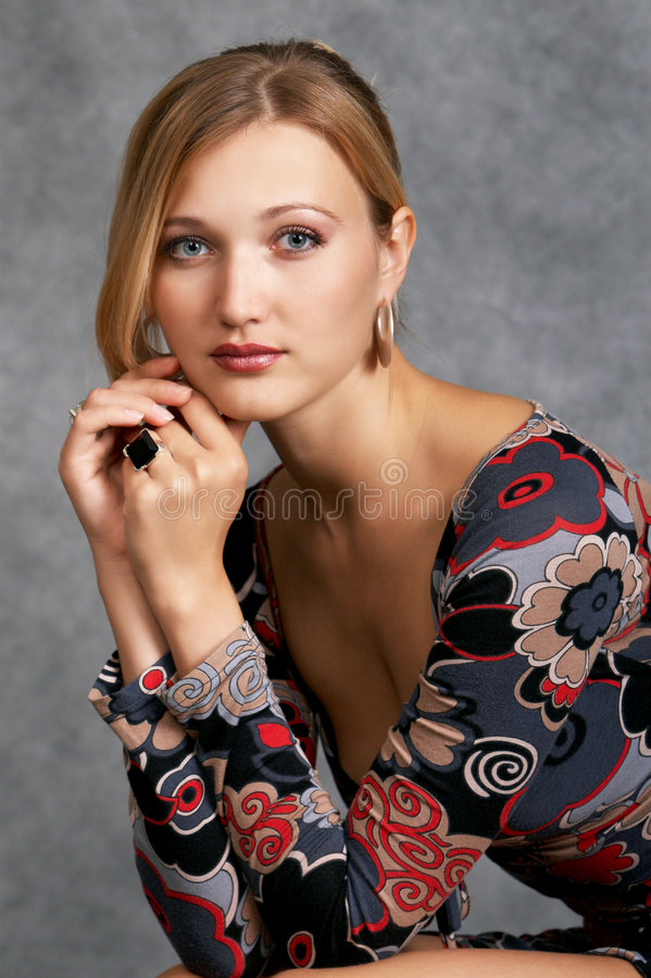 Class act high society woman. On a dark background stock photos