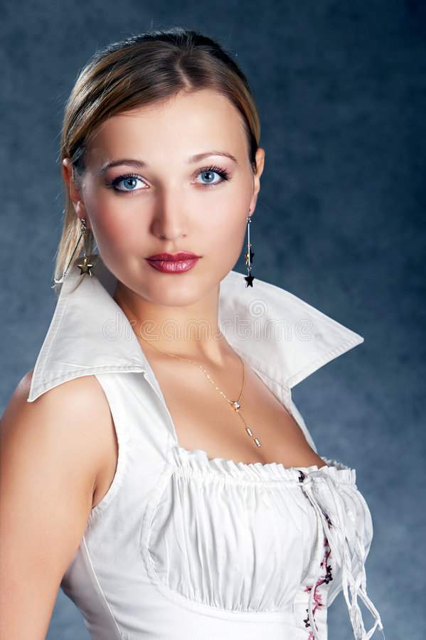 Class act high society woman. On a dark background royalty free stock images