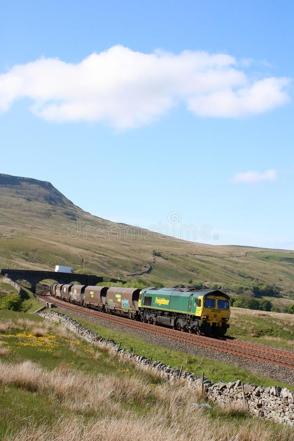 Class 66 on coal train Settle to Carlisle Ais Gill. Freightliner Heavy haul class 66 diesel-electric locomotive number 66516 on a coal train approaching Ais Gill royalty free stock images