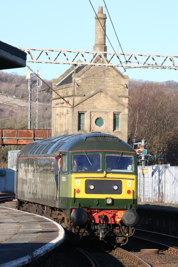Class 47 diesel-electric locomotive in two tone green livery carrying original number D1924 leaving Carnforth station on 28th stock photos