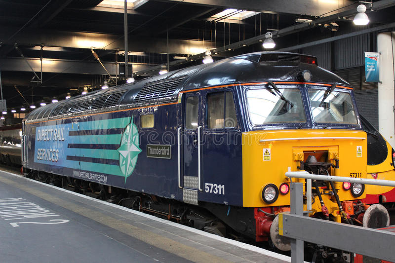 Class 57 diesel Thunderbird, Euston Station London. Class 57 diesel locomotive number 57311 named Thunderbird in Direct Rail Services (DRS) livery at a platform royalty free stock images