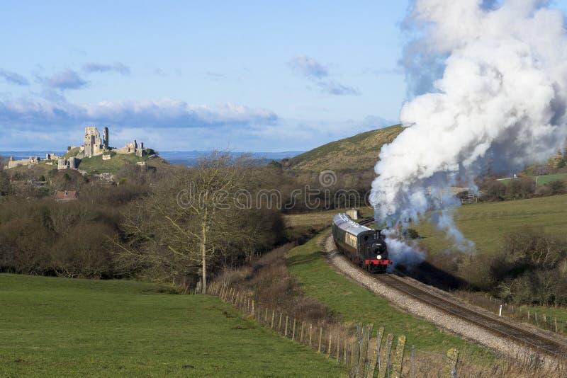 Steam Train on the Swanage Railway near Corfe Castle, Dorset.England. A class M7 tank locomotive number 30053 heads the 12.15pm steam train from Corfe Castle to stock photos