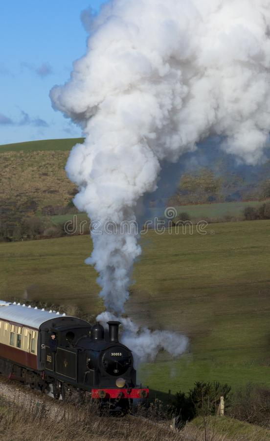 Steam Train on the Swanage Railway near Corfe Castle, Dorset.England. A class M7 tank locomotive number 30053 heads the 12.15pm steam train from Corfe Castle to stock images