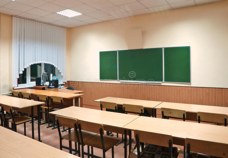 Class room with a school board. And school desks royalty free stock images