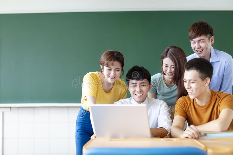 University Students Using Laptops In classroom. Class Of University Students Using Laptops In classroom royalty free stock photography
