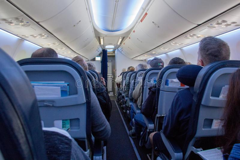Classe touriste intérieure commerciale de transports aériens image libre de droits