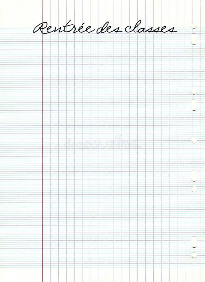 Classes de DES de Rentree, signifiant de nouveau à l'école en français, écrit sur une feuille d'école de papier rayée image libre de droits
