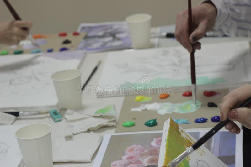 Classes do grupo na pintura foto de stock royalty free