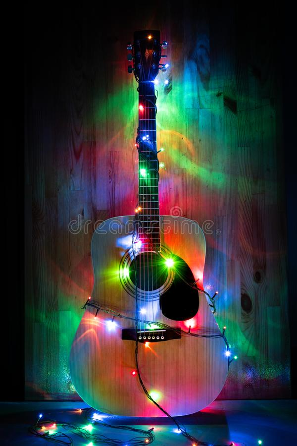 Classic Acoustic Guitar in christmas lights. Classic Acoustic Guitar in christmas led lights stock photography