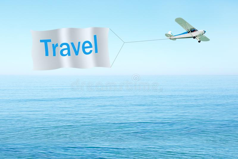 Classic airplane pulling banner with text-Travel on sky, sea background. Travel concept. Planning vacation royalty free stock photography