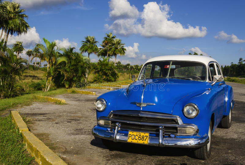 Classic American blue car one of streets in Havana, royalty free stock photography