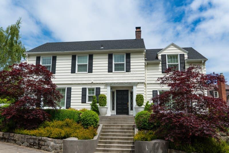 Classic American clapboard suburban house. Clapboard suburban house in classic American-style stock photo