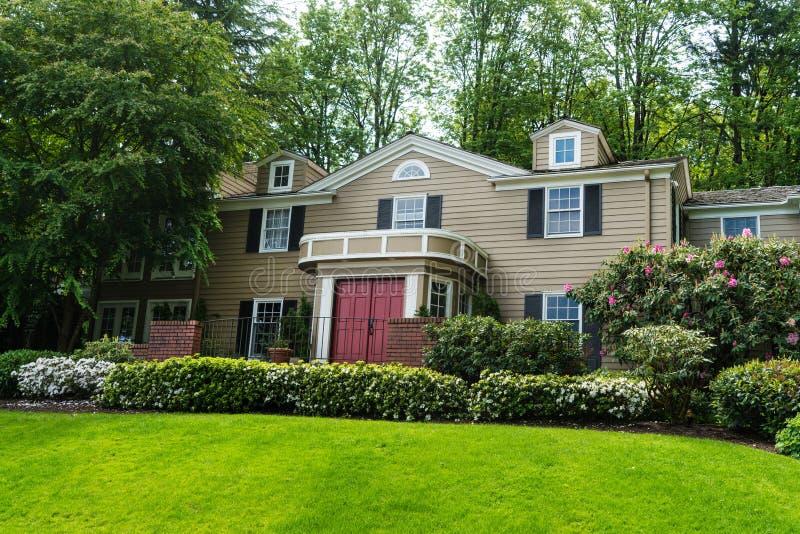 Classic American clapboard suburban house. Clapboard suburban house in classic American-style stock photography