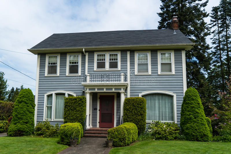 Classic American clapboard suburban house. Clapboard suburban house in classic American-style stock images