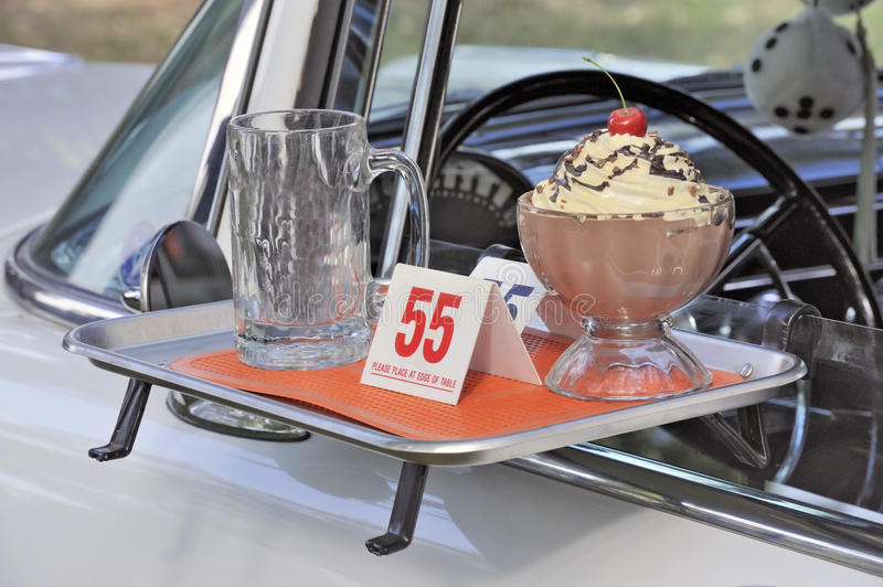 Classic american fifties car and fastfood theme. Closeup of classic american fifties car and fastfood theme royalty free stock photo