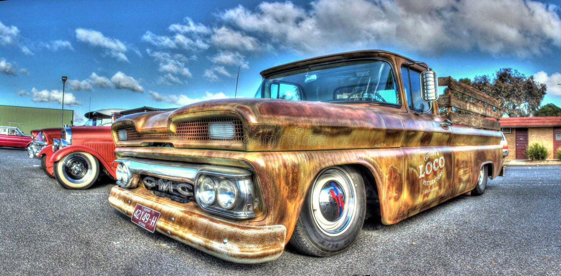 Classic American GMC pickup truck. Classic American unrestored GMC pickup truck with wood rails on display at a car and bike show in Melbourne, Australia stock photo