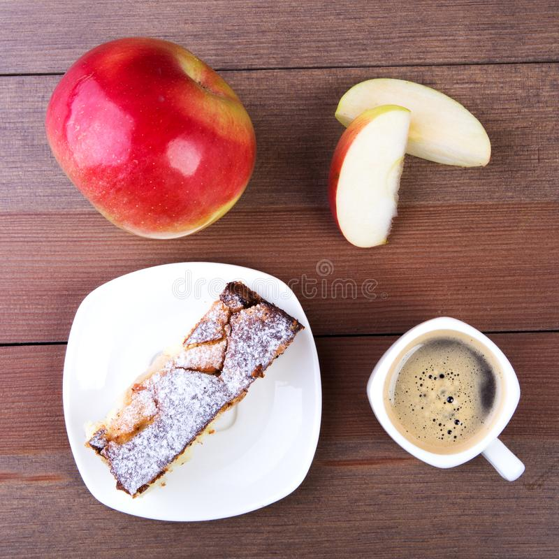Classic American Homemade apple pie. Piece of tasty Organic Apple Pie and cup with espresso coffee. Dessert Ready to Eat royalty free stock images