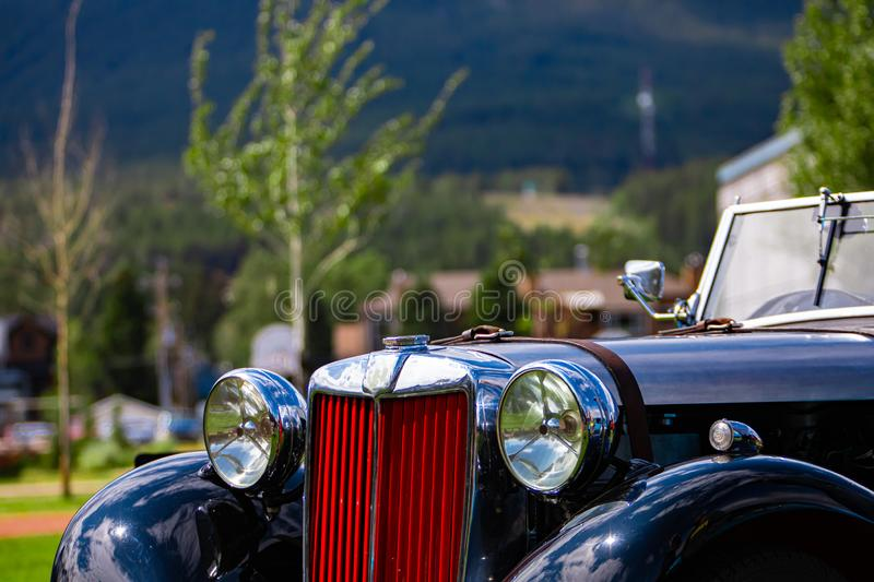 A classic antique black car, red Grille stock images