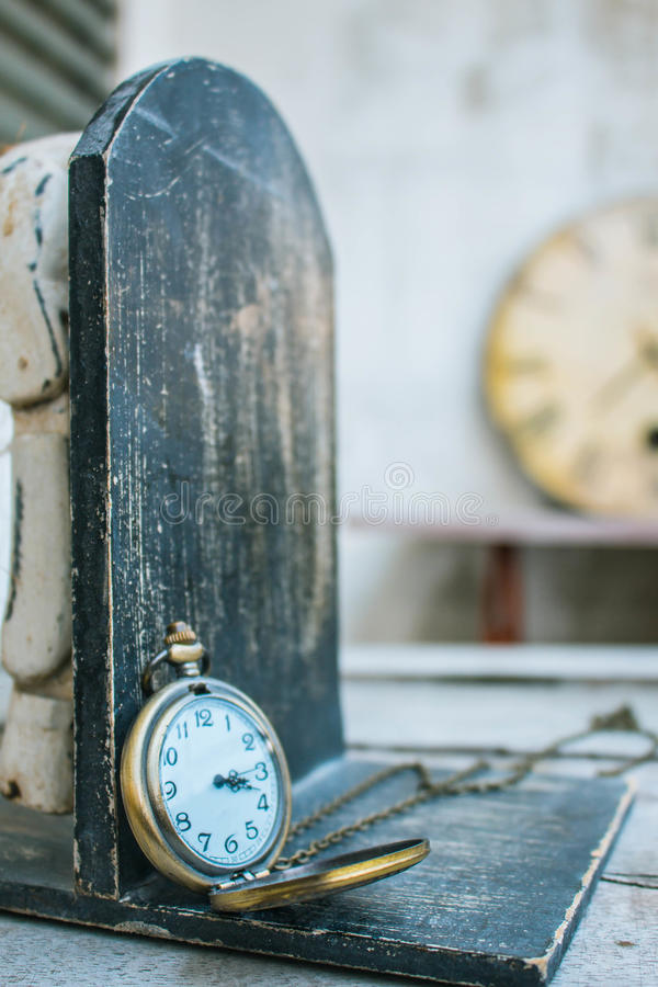 Classic antique clock. On wood stock photo