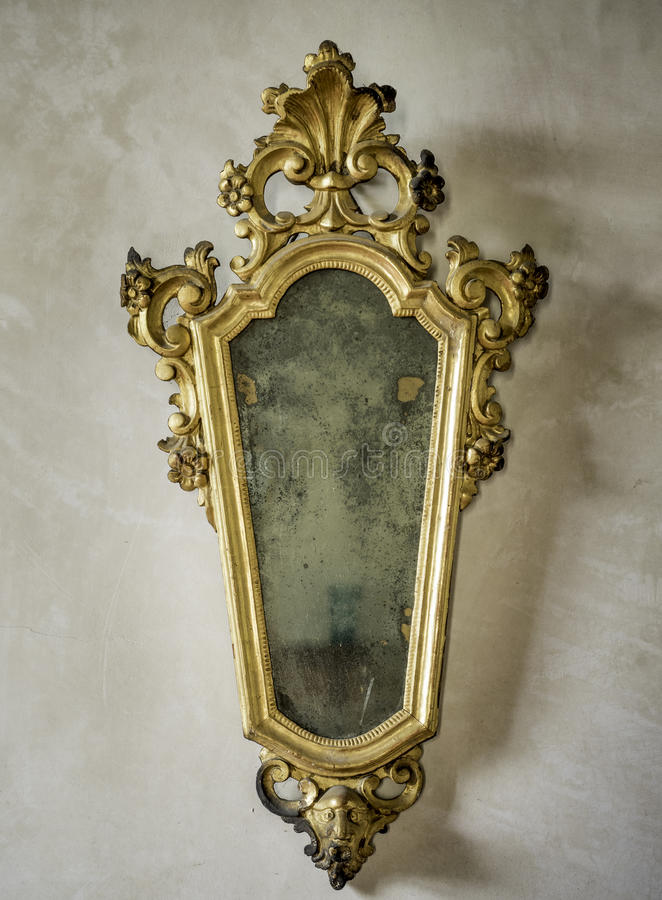 Classic antique mirror with gilded frame. Engraved royalty free stock image