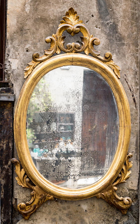 Classic antique mirror with gilded frame. Engraved stock photo
