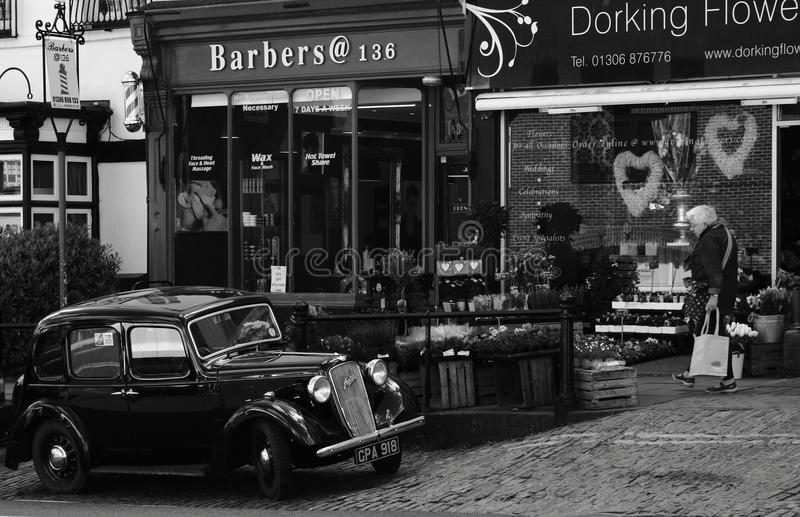 A Classic Austin Ruby Car Parked Outside Modern Shops. High Street, Dorking, Surrey, United Kingdom, 25 April, 2017: An Austin Ruby Car Parked Outside a Flower stock photography