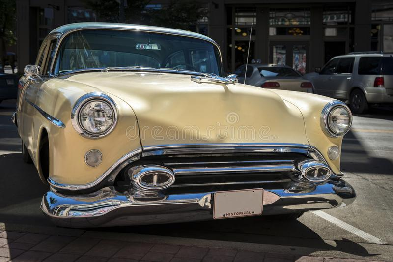 Classic automobile parked at the curb royalty free stock photography