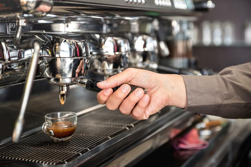 Classic barman hand preparing italian espresso at modern coffee royalty free stock photos