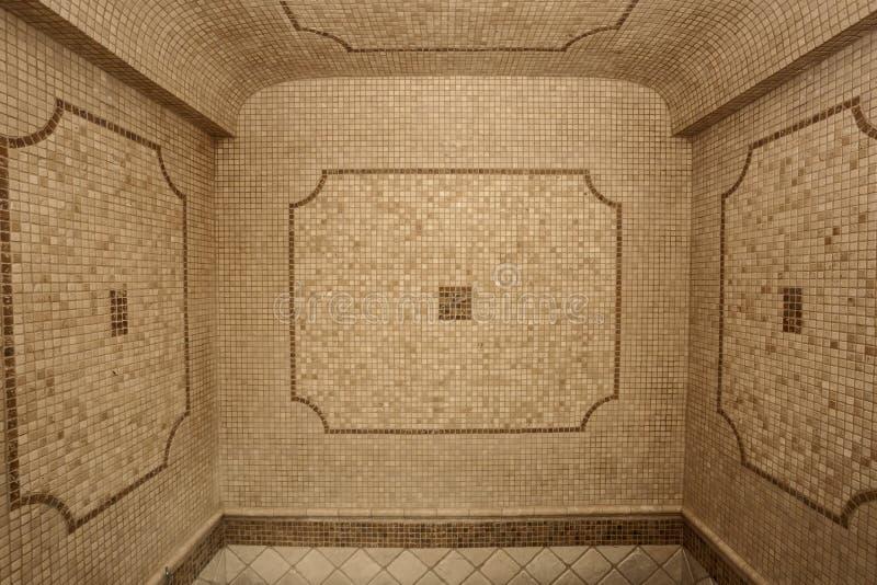 Classic bathroom ceramic-mosaic tile walls. Beautiful classic view of bathroom ceramic- mosaic stylish beige tile walls stock images