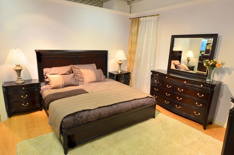 Classic bedroom wooden furniture. Classic hard wood bedroom furniture turned up to be modern stock images