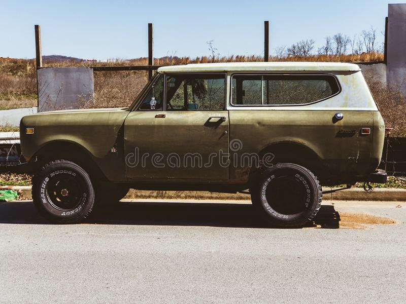 Classic Beige and White Sports Utility Vehicle on Road royalty free stock photography