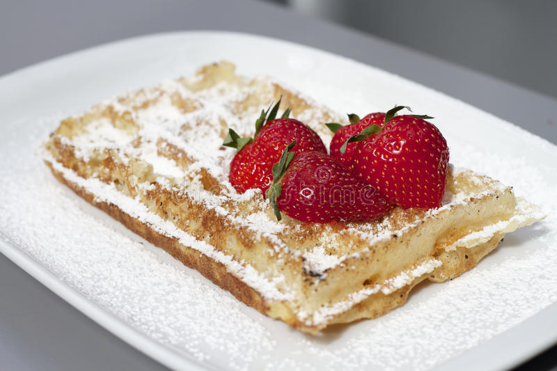 Classic Belgian Waffle And Red Strawberries Stock Photos