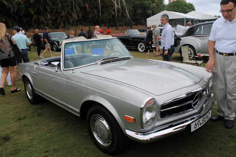 Classic benz sl front quarter view. Classic 1969 Mercedes benz 280 sl convertible sports car being admired at classic car show in south florida stock images