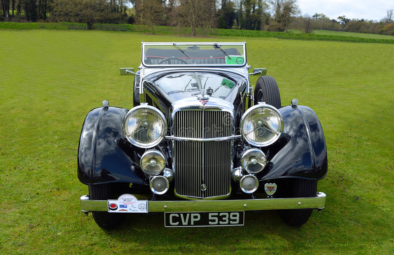 Classic Black Alvis motor car parked on grass. royalty free stock image