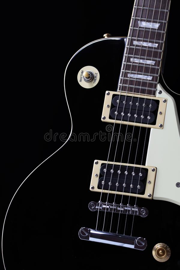 Classic black electric guitar body with white scratchplate stock images