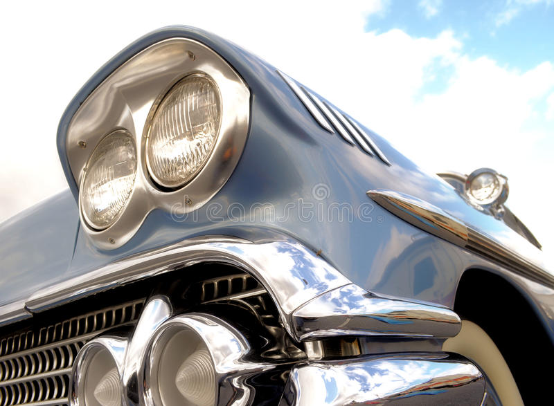 Classic blue car with clouds and sky stock photo