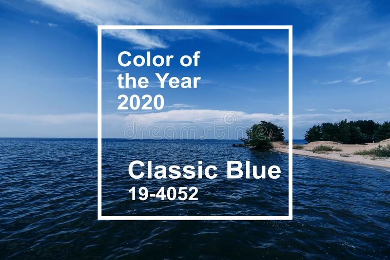 Classic Blue color of the Year 2020. blue clear sky with waves on water of sea and a sandy beach on summer day. Classic Blue color of the Year 2020. blue clear stock photography