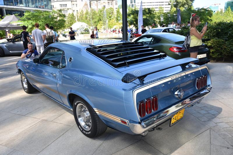 Classic blue Ford Mustang Mach 1 1969. WARSAW, POLAND - JUNE 09, 2018: Classic blue Ford Mustang Mach 1 1969. Free autoshow `Kawa i Samochody` on European square royalty free stock photo