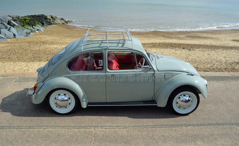 Classic Blue Grey Volkswagen Beetle Motor Car Parked on Seafront Promenade. FELIXSTOWE, SUFFOLK, ENGLAND - MAY 07, 2017: Classic Blue Grey Volkswagen Beetle stock image