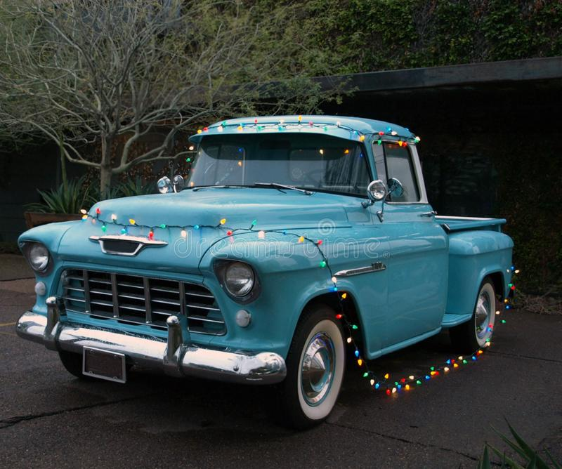 Classic Blue Pickup Truck Strung With Christmas Lights obrazy stock