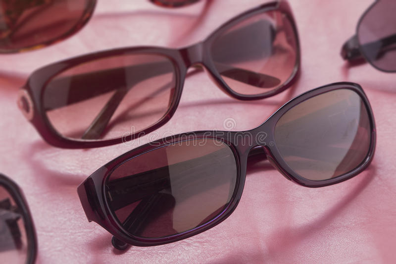 Classic brand name sunglasses in apparel shop at discount and ma royalty free stock photos