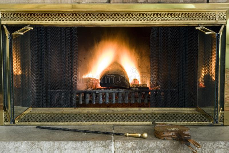 Classic brass hearth fireplace stock image